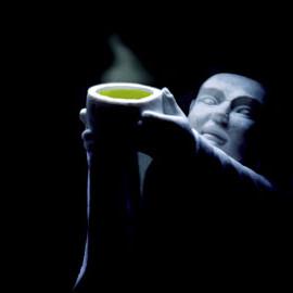 monk offering green tea