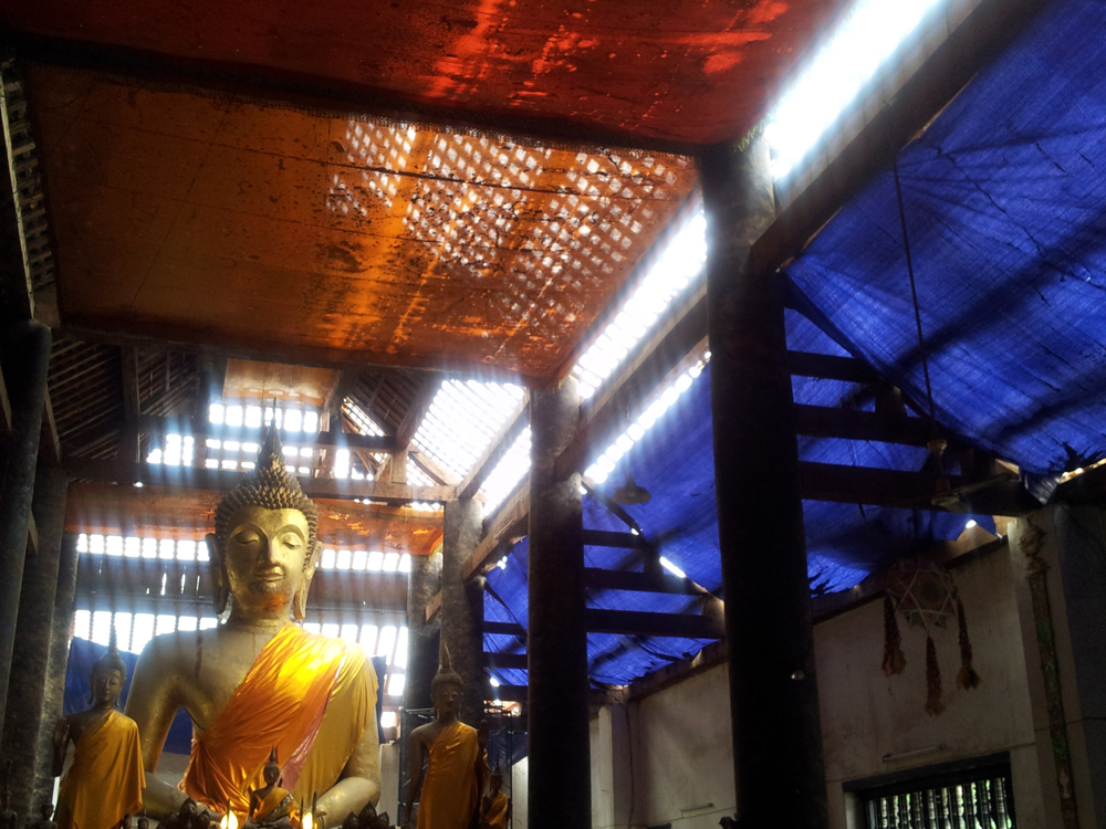 Buddha statue in a temple being restored in Luang Prabang, Laos