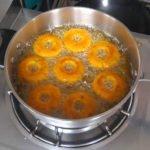 Sweet potato doughnuts frying