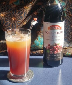 Foggy Sunset with bottle of Marco Polo sour cherry syrup