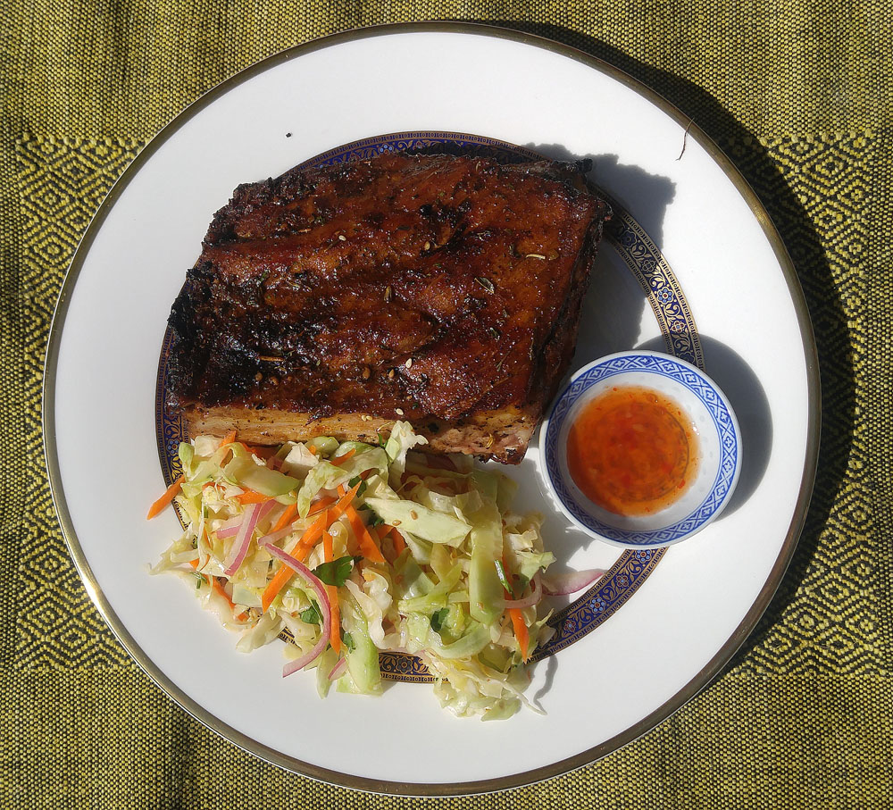 BBQ pork ribs served with Asian slaw and a dab of Thai sweet chili sauce.