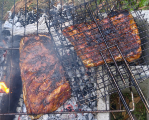 Ribs roasting over wood fire.
