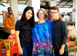The author, center, and her son Danny with new friend Tuli