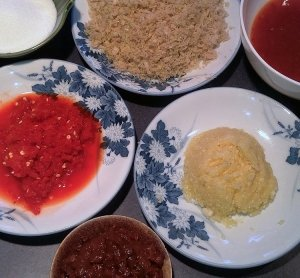 Clockwise from top left: sugar, lemongrass,Thai sweet chili sauce, garlic,fermented bean sauce, fresh red chilies