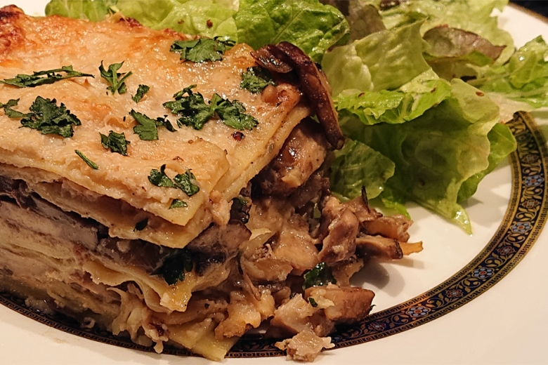 White mushroom lasagna served with salad