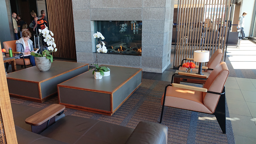 Fireplace and orchids in the Paine Field Airport lounge
