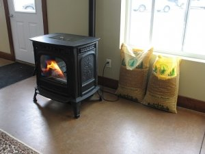A pellet stove and 2 bags of wood pellets