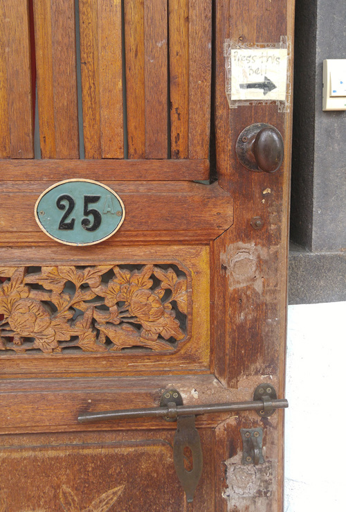 carved door with #25