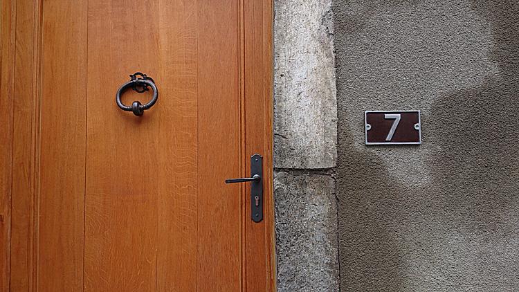wood door, stone jamb, stuccoed wall #7
