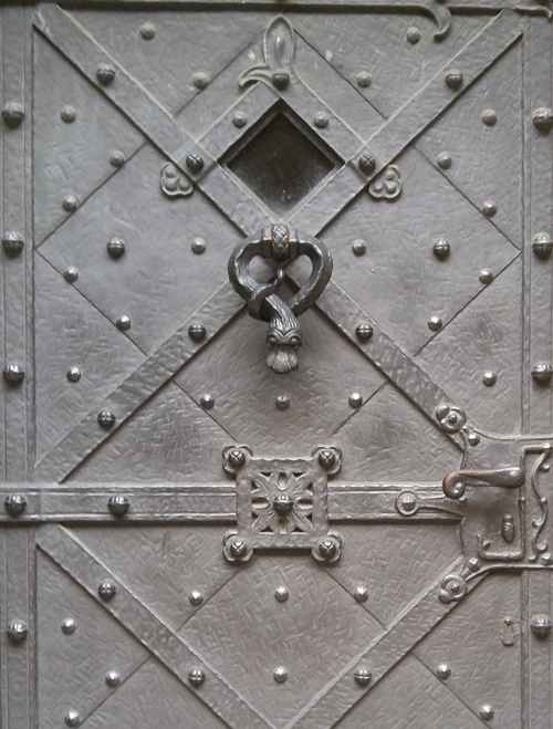 A lead or pewter door in Prague with a serpent knocker