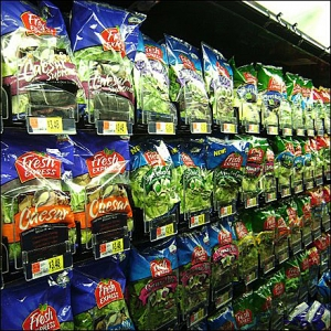 rows of bagged salad mixes