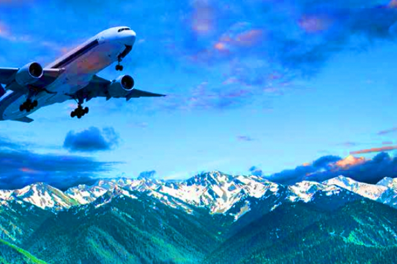 Airliner above snowcapped mountains