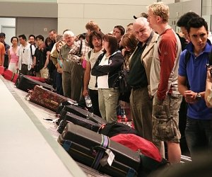 people standing at baggage carousel