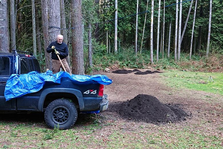 Bill shoveling compost