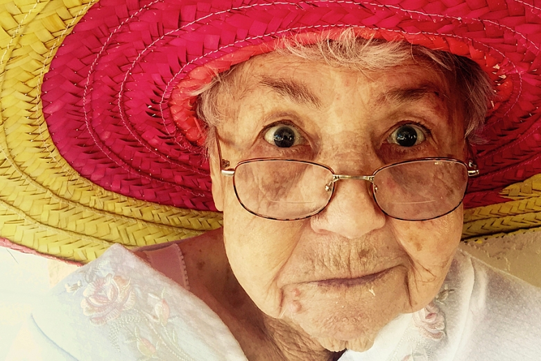 old woman in bright hat