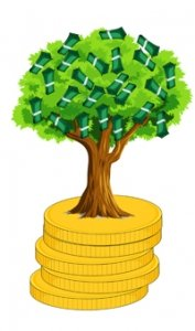 dollar bills blossom on the tree sitting on a stack of coins