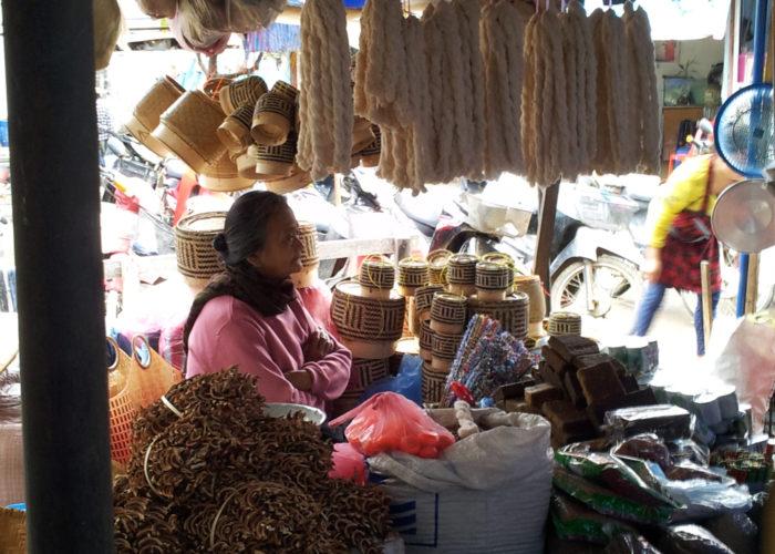 Seller of sticky rice serving baskets