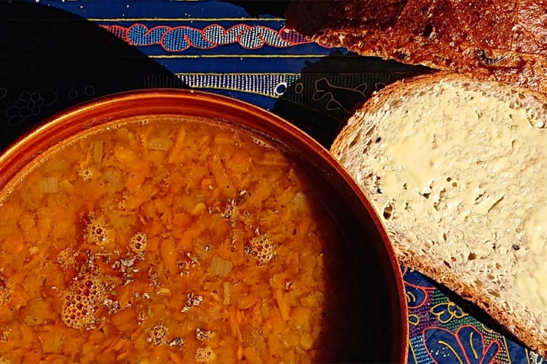 carrot-red lentil soup and slice of bread