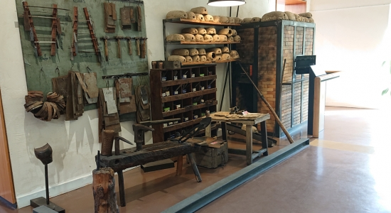 A display of tools and a forge for making sheep bells.